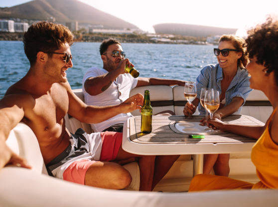 four people eating lunch on boat